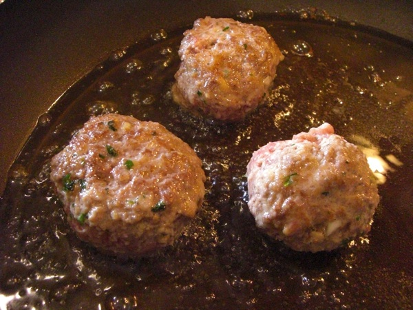 Once the meatballs are cooked, they can be added to the sauce. Allow ...